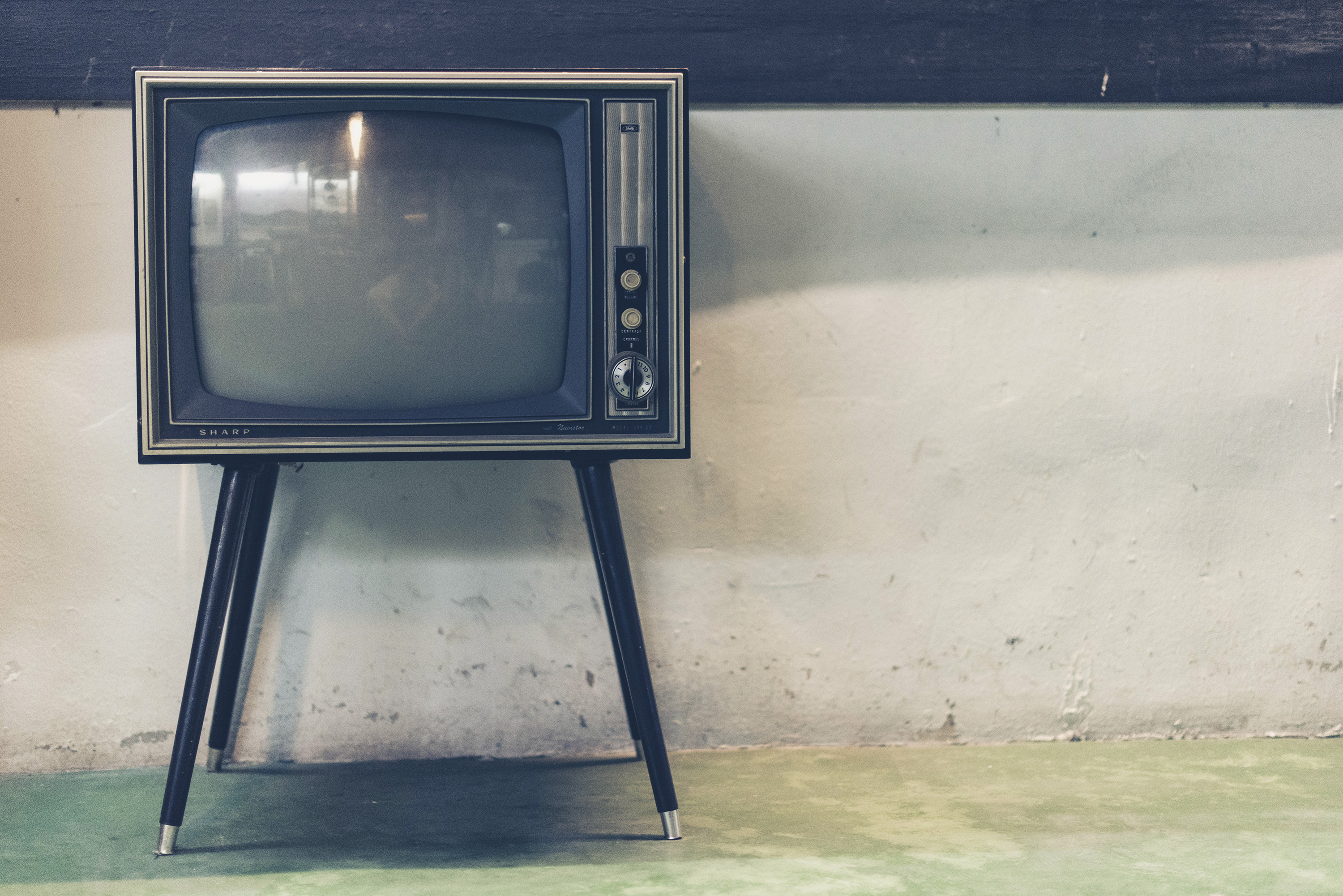 Gray vintage TV. Turning of the TV can help maintain good sleep.