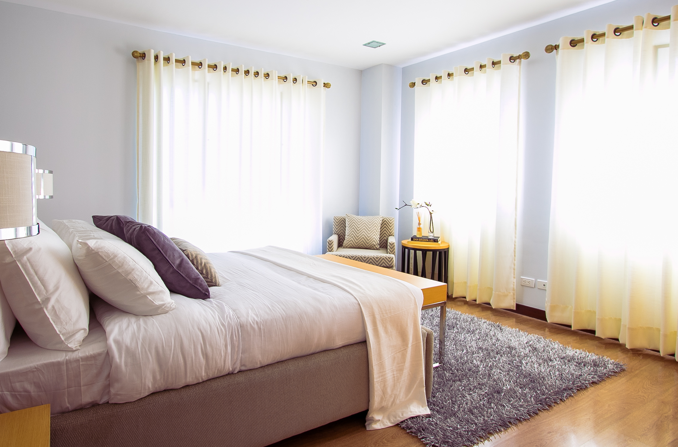 Bedroom, with lots of light and a well made bed. A good mattress is essential for a good sleep.